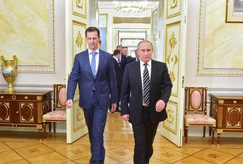 Tổng thống Putin (phải) và người đồng cấp Syria Assad.