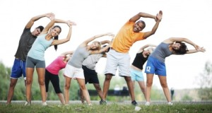 Group-of-people-doing-stretching-exercises.--500x281