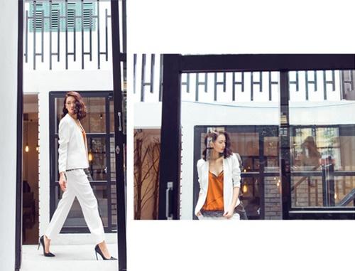 Trong khi đó quý cô này lại làm mới cho set đồ street style của mình bằng cách kết hợp áo hai dây camisole và suit công sở